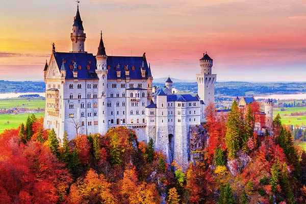 Germany. Famous Neuschwanstein Castle in the background of trees
